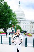 Health care professional holding wall clock on streets of Washington DC Stock Photos