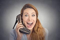 Headshot happy woman looking excited holding high heeled shoe as phone Stock Photos