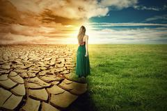 A Climate Change Concept Image. Landscape green grass and drought land Stock Photos