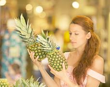 Woman shopping in supermarket, fruit section Stock Photos