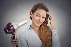 portrait beautiful woman with a hairdryer - stock photo