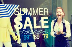 Shopping girl in front of store window display Stock Photos