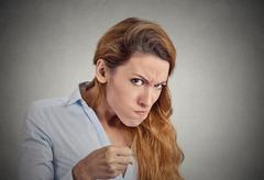Portrait angry woman on grey background. Negative emotion Stock Photos
