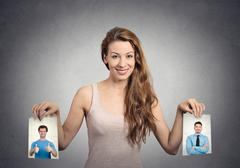 Beautiful woman undecided about which man to choose. Human emotions Stock Photos