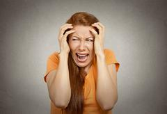 stressed upset woman having breakdown - stock photo
