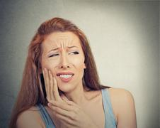Woman with sensitive tooth ache crown problem Stock Photos