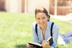 Happy student girl excited to get back to school university - stock photo