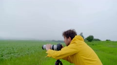 Professional photographer takes a picture of nature Stock Footage