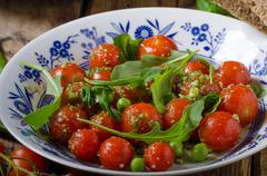 Salad of arugula and cherry tomatoes Stock Photos
