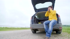 Anger man with his broken down car angry and crying - stock footage