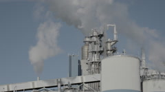 Smoke coming from a large pulp factory - stock footage