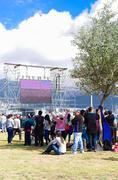 QUITO, ECUADOR - JULY 7, 2015: Big screen at pope Francisco mass, people far Stock Photos