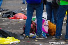QUITO, ECUADOR - JULY 7, 2015: Mens legs guarding some bags on the floor, behind Stock Photos