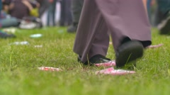 People throw garbage on the ground at a mass event Stock Footage