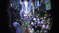 1944: Asian market busy people walking fast indoor high ceilings building. Stock Footage