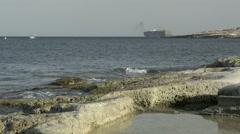 Container ship leave Malta free port near Marsaxlokk salt - stock footage
