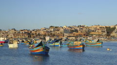 MULTI-COLOURED FISHING BOATS MARSAXLOKK MALTA Stock Footage