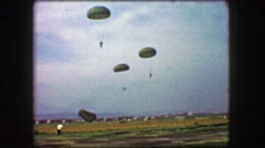 1944: Paratrooper soldiers landing airplane drop military training exercise. Stock Footage