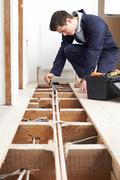 Male Plumber Fitting Central Heating System Stock Photos