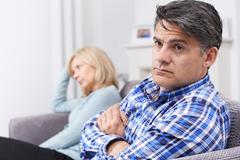 Couple With Relationship Difficulties Sitting On Sofa - stock photo