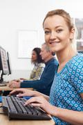 Portrait Of Woman Attending Computer Class - stock photo