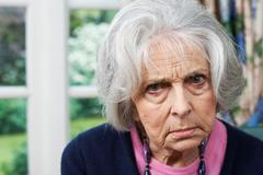 Head And Shoulders Portrait Of Angry Senior Woman At Home - stock photo
