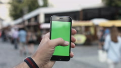 Close-up of male hands using smartphone outdoors in the city center. hroma Key Stock Footage