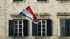 CROATIAN FLAG SHUTTERS OLD TOWN DUBROVNIK CROATIA Stock Footage