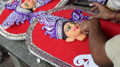 Artist preparing Goddess Durga clay idol, Kolkata, Calcutta, India Stock Footage