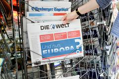 Woman buying Die Welt newspaper with shocking headline about Brexit Stock Photos