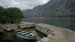 SMALL BOAT MOORED IN COVE KOTOR MONTENEGRO Stock Footage
