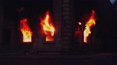 SAINT-PETERSBURG, RUSSIA, JUNE 25, 2016. Fire burns inside window of house. 4K Stock Footage
