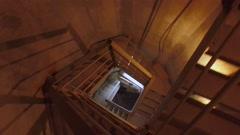 Grunge dark industrial spiral staircase Stock Footage