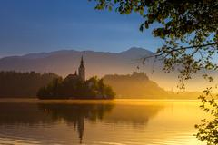 Magical sunrise of Lake Bled with island Stock Photos