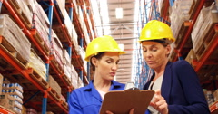 Warehouse worker working with clipboard Stock Footage