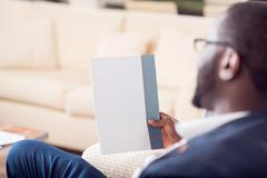 Afro American man holding blank paper - stock photo