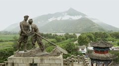 Bronze staute on Jinsha river, China Stock Footage