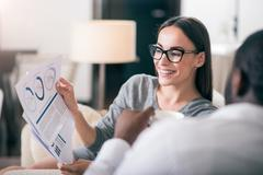 Woman showing diagram to her colleague Stock Photos