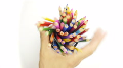 Color pencils into basket. Stock Footage