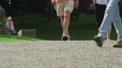LEGS FEET WALKING ON PATH NORTH YORKSHIRE ENGLAND - stock footage