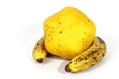 Yellow Paw Paw Encased by Two Ripe Speckled Bananas Stock Photos