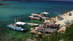 FISHING BOATS BLUE WATER KARPAS PENINSULA CYPRUS Stock Footage