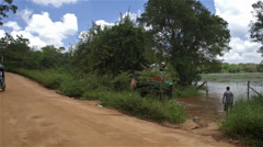 GREEN TUC TUC ELEPHANT RIDE SIGIRIYA SRI LANKA Stock Footage