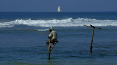 LONE STILT FISHERMAN YACHT WELIGAMA SRI LANKA ASIA Stock Footage