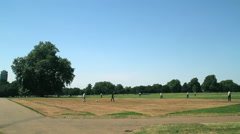 PEOPLE PLAYING CRICKET HYDE PARK LONDON Stock Footage