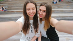 Lifestyle selfie portrait of two young positive woman having fun and making Stock Footage