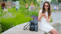 Young woman taking self portrait in european city. Caucasian tourist enjoy her Stock Footage