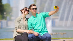 Young tourist couple traveling on holidays in Europe smiling happy. Caucasian Stock Footage