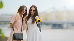 Young beautiful girls having fun and making selfie. Concept of friendship and Stock Footage