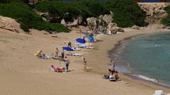 TOURISTS SMALL INLET BEACH KARPAS PENINSULA CYPRUS Stock Footage